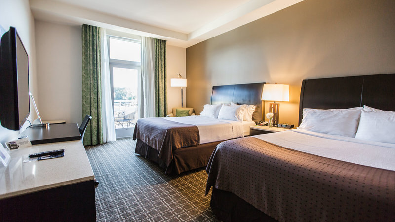 Holiday Inn Charleston Historic Downtown-Guest room with two queen beds overlooking outdoor pool and patio<br/>Image from Leonardo