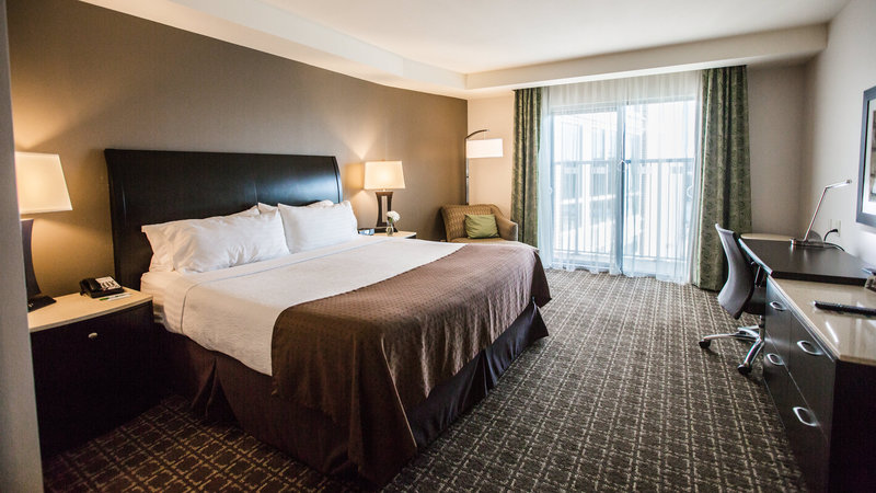 Holiday Inn Charleston Historic Downtown-Feature room with king bed, private balcony and chairs<br/>Image from Leonardo