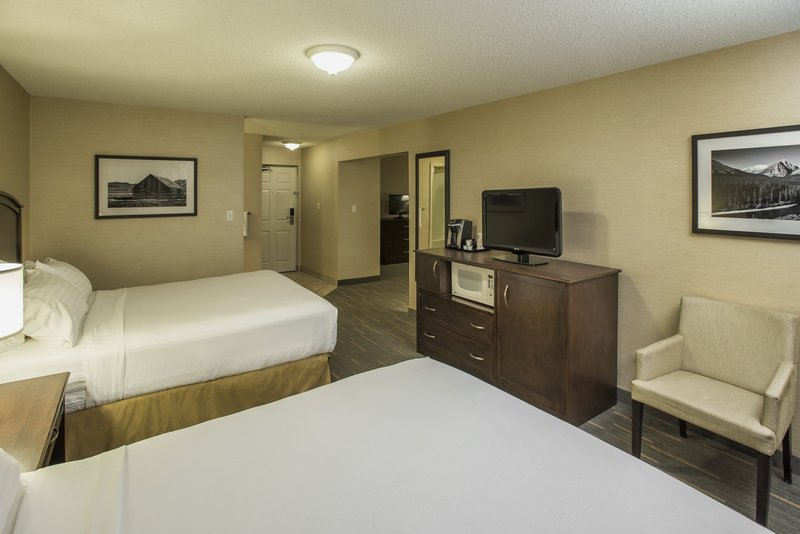 Holiday Inn Lethbridge-Bedroom with 2 Queen beds with adjacent living room<br/>Image from Leonardo