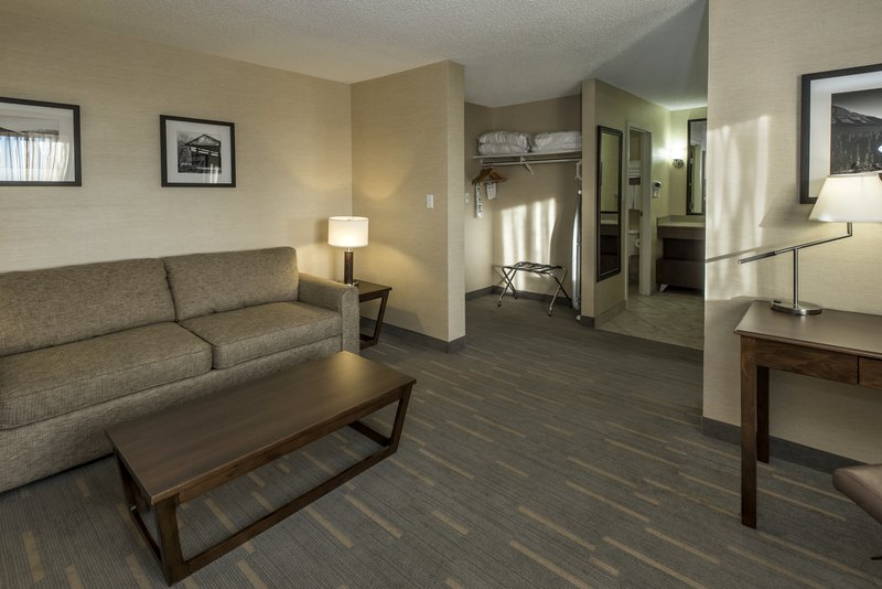 Holiday Inn Lethbridge-Living room space connecting to bedroom<br/>Image from Leonardo