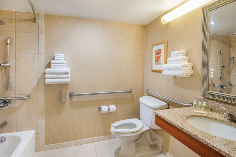 Holiday Inn Hotel & Suites Cincinnati-Eastgate (I-275e)-Guest bathroom with ADA accessible tub.<br/>Image from Leonardo