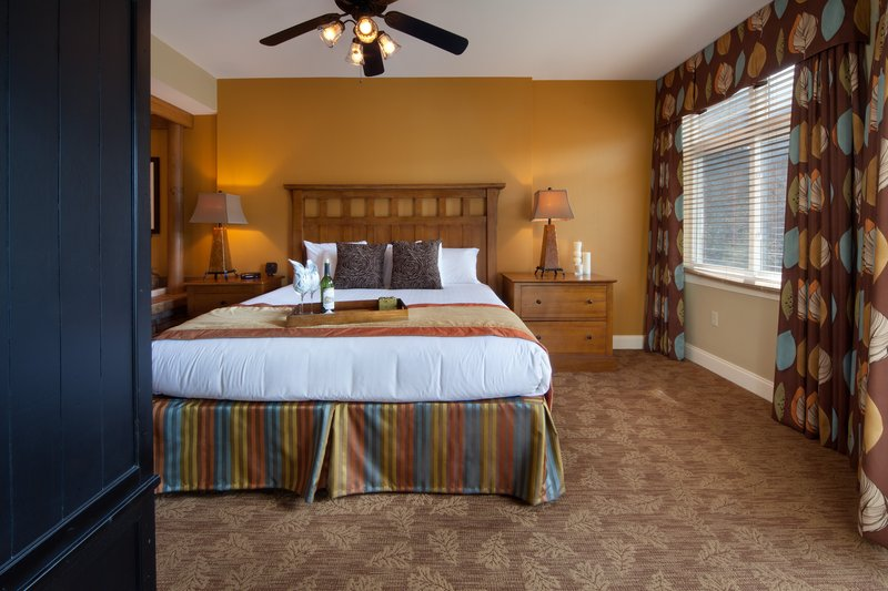 Holiday Inn Club Vacations Gatlinburg-Smoky Mountain Resort-Beautifully decorated master bedroom with king size bed<br/>Image from Leonardo