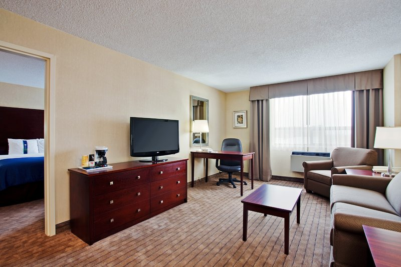 Holiday Inn Hotel & Suites Winnipeg-Downtown-King Executive Suite-living room with wet bar<br/>Image from Leonardo