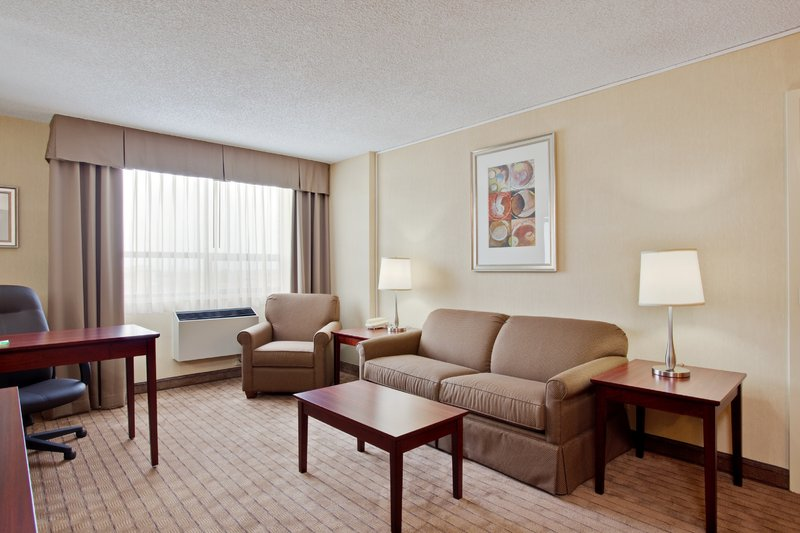 Holiday Inn Hotel & Suites Winnipeg-Downtown-King Executive Suite-large sitting area<br/>Image from Leonardo