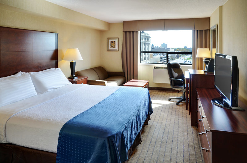 Holiday Inn Hotel & Suites Winnipeg-Downtown-Relax in a spacious king room with seating area!<br/>Image from Leonardo