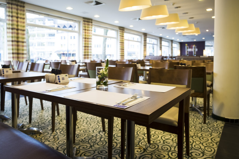 Holiday Inn Express Guetersloh-Bright colors and high quality materials decorate the restaurant.<br/>Image from Leonardo