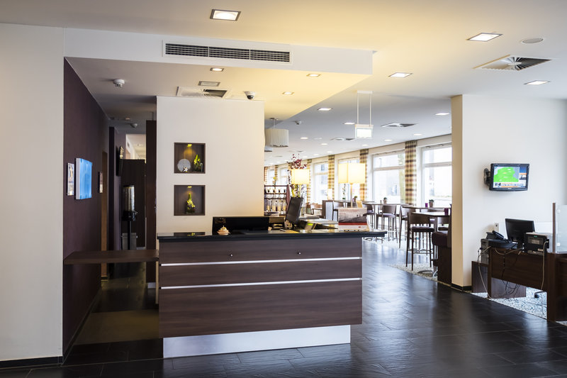 Holiday Inn Express Guetersloh-Our warm reception team is there for you.<br/>Image from Leonardo