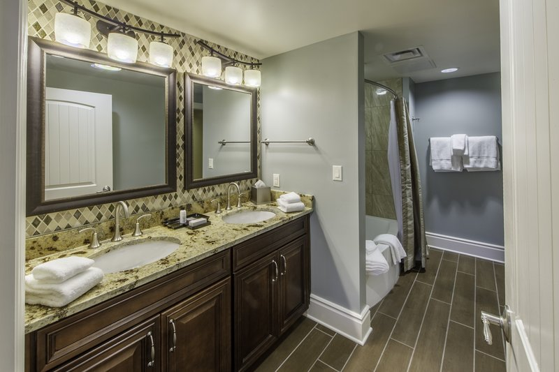 Holiday Inn Club Vacations Gatlinburg-Smoky Mountain Resort-Signature Collection 2 bedroom guest bath with shower/tub combo<br/>Image from Leonardo