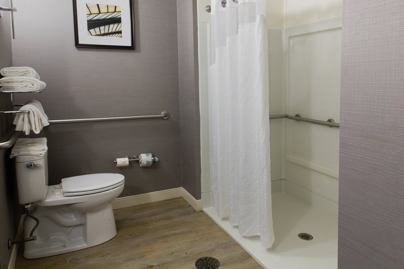 Holiday Inn Hotel & Suites Bloomington - Airport-ADA Two queen guest room includes a spacious roll in shower<br/>Image from Leonardo