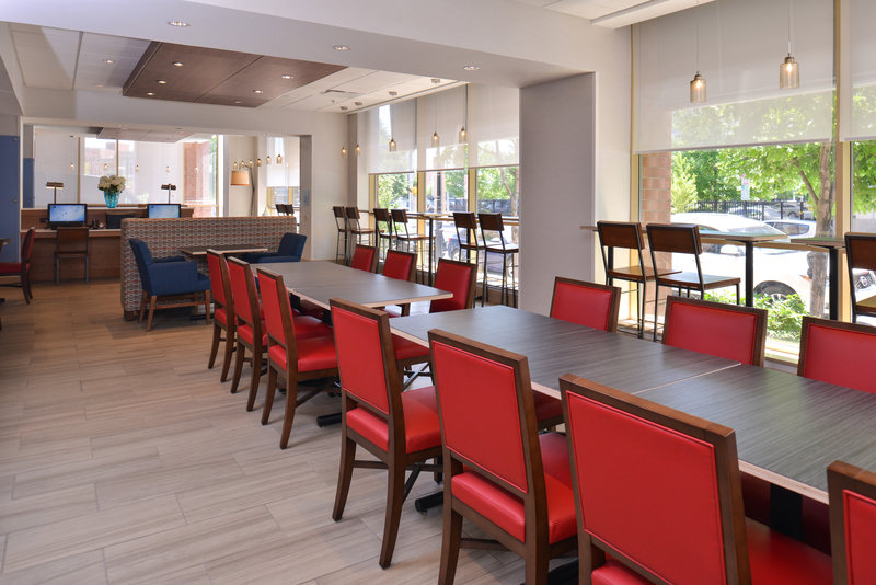 Holiday Inn Express & Suites Buffalo Downtown-Breakfast sitting area and large open lobby for groups to hang out<br/>Image from Leonardo