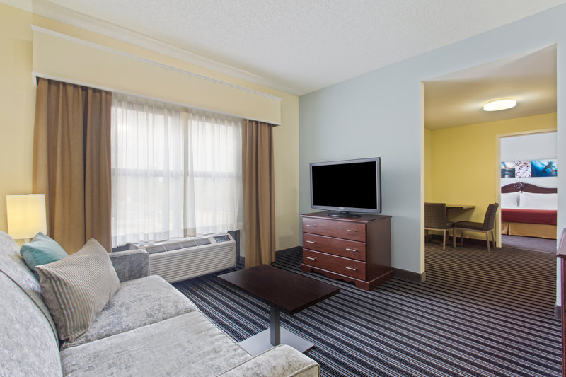 Holiday Inn Express Hotel & Suites Clearwater North/Dunedin-King Executive Suite living area<br/>Image from Leonardo