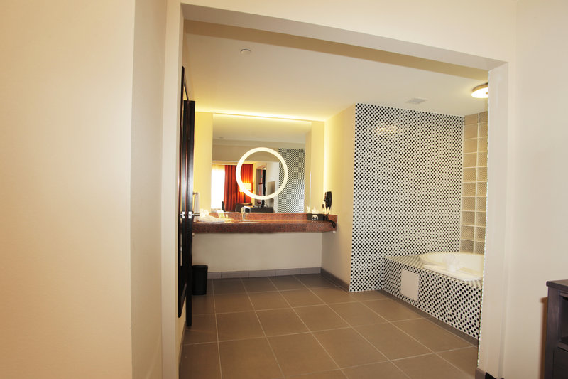Holiday Inn Amarillo West Medical Center-Our guest bathrooms have plenty of counter space to get ready.<br/>Image from Leonardo