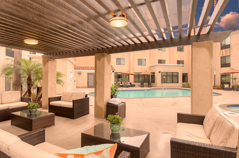 Holiday Inn Express & Suites Carlsbad Beach 4.4/5 | 506 Revi-Guest Patio with heated pool and spa<br/>Image from Leonardo