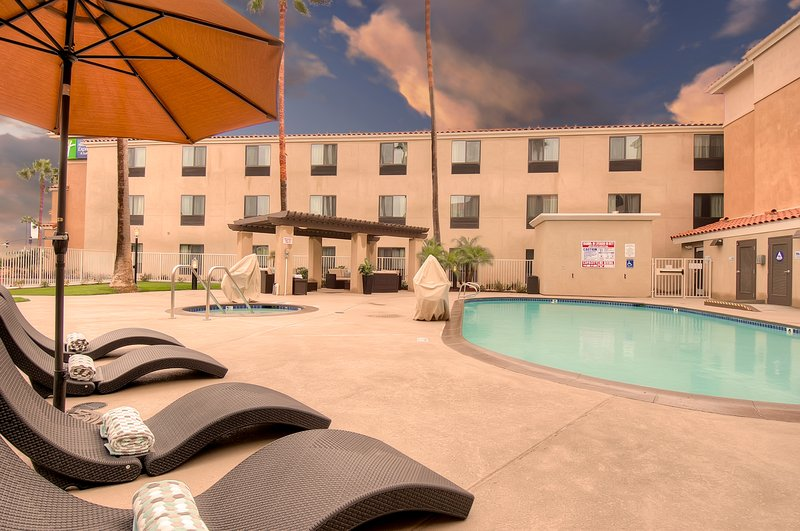 Holiday Inn Express & Suites Carlsbad Beach 4.4/5 | 506 Revi-Pool with lounge seating<br/>Image from Leonardo