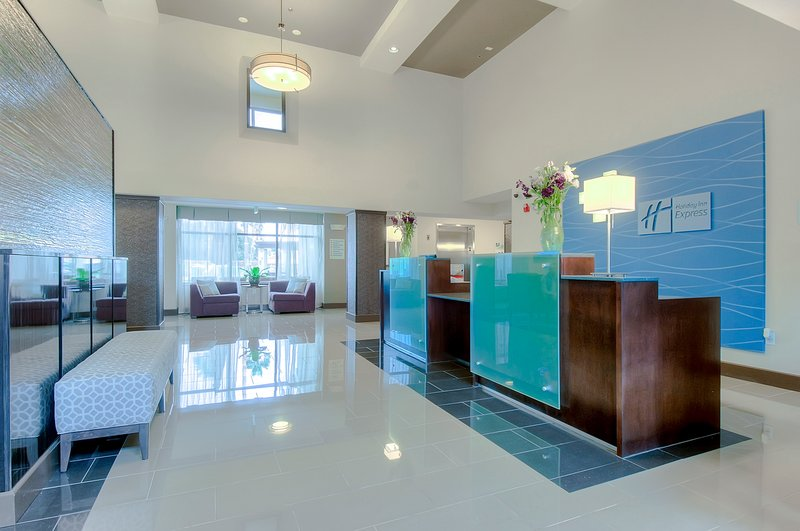 Holiday Inn Express & Suites Carlsbad Beach 4.4/5 | 506 Revi-Inviting Entrance and Reception Desk<br/>Image from Leonardo