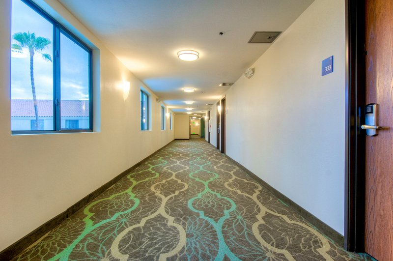 Holiday Inn Express & Suites Carlsbad Beach 4.4/5 | 506 Revi-Quiet hallway leading to your room<br/>Image from Leonardo