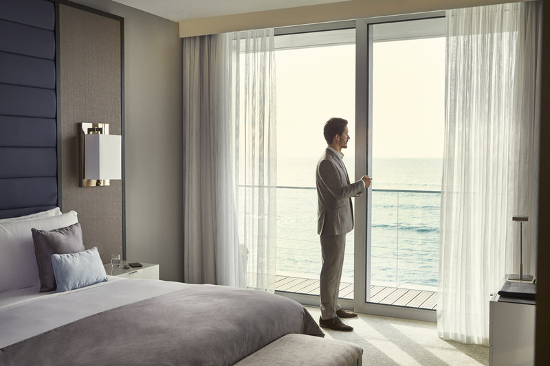 Intercontinental Estoril-Business Man looking the Ocean View from the suite<br/>Image from Leonardo