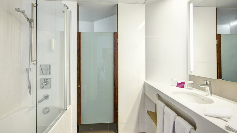 Crowne Plaza Brugge-Guest Bathroom with Bath and Rainshower<br/>Image from Leonardo