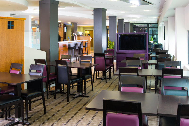 Holiday Inn Express Glasgow - City Centre Riverside-Keep yourself up-to-date with the news while tucking into breaky<br/>Image from Leonardo