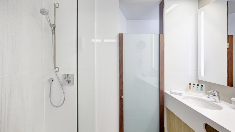 Crowne Plaza Brugge-Guest Bathroom with rainshower<br/>Image from Leonardo