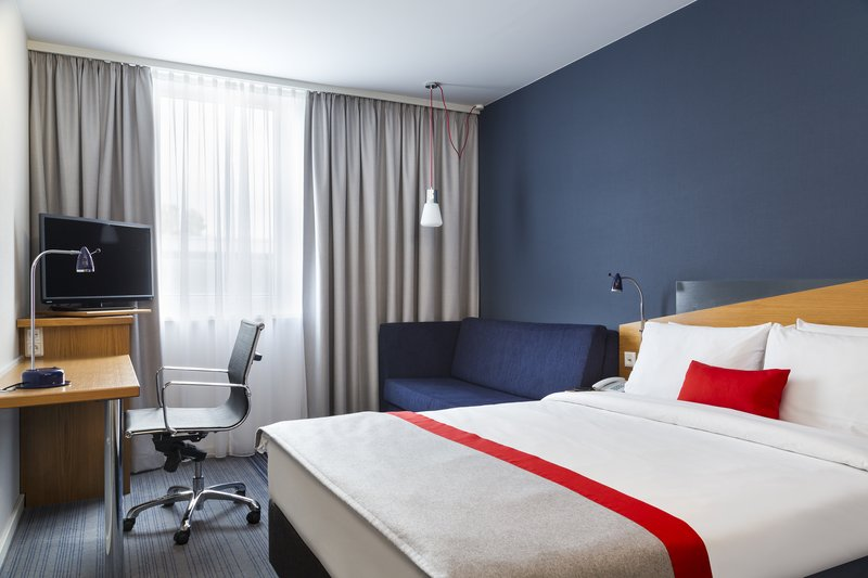 Holiday Inn Express Dortmund-Comfortable Queen Bed Guest Room with pull-out sofa bed<br/>Image from Leonardo