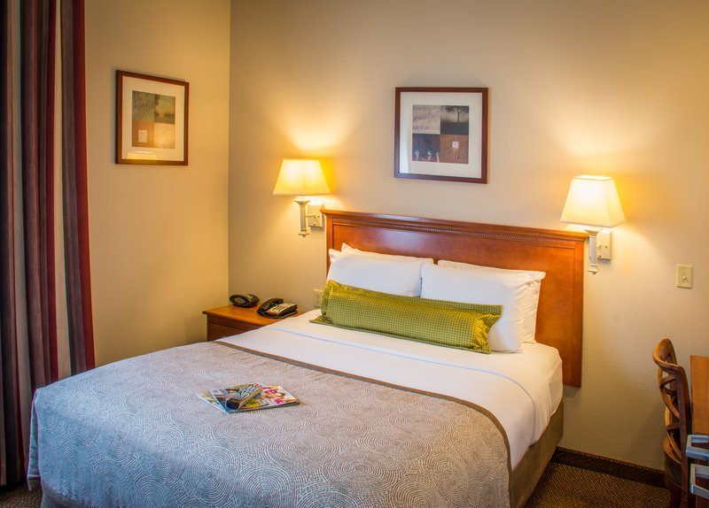 Candlewood Suites South Bend Airport-Bedroom in One Bedroom Suite with Private TV, Workdesk and Closet<br/>Image from Leonardo