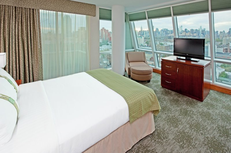 Holiday Inn L.I. City-Manhattan View-Queen Bed Room with Balcony offers outstanding views of skyline<br/>Image from Leonardo