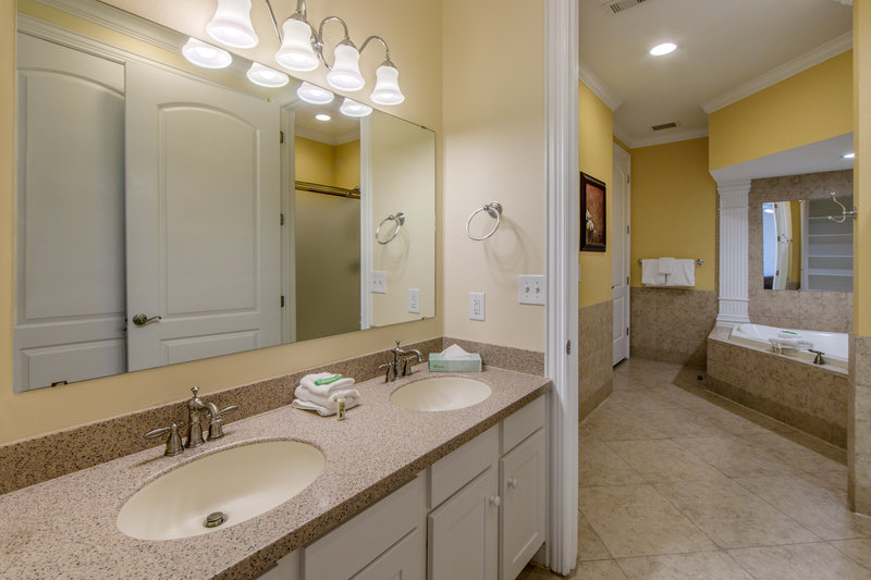 Holiday Inn Club Vacations Galveston Beach Resort-Dual sinks in a private bathroom <br/>Image from Leonardo