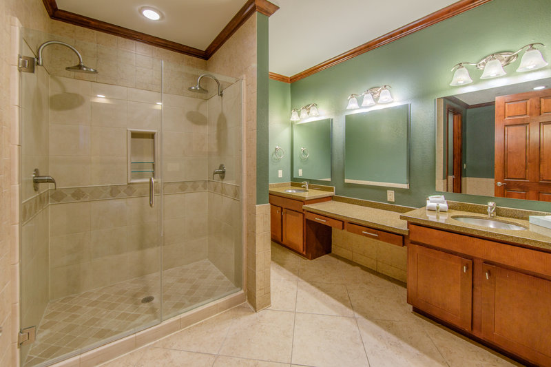 Holiday Inn Club Vacations Galveston Beach Resort-Private bathroom and shower with dual shower heads <br/>Image from Leonardo