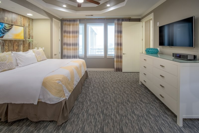 Holiday Inn Club Vacations Galveston Beach Resort-Watch TV from a comfy Signature Collection king sized bed <br/>Image from Leonardo