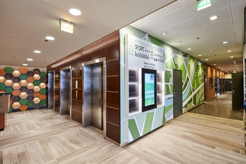 Holiday Inn Helsinki - West -Ruoholahti-A bright lobby allows easy transition to guest rooms and meetings<br/>Image from Leonardo