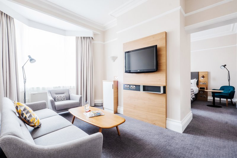 Holiday Inn Farnborough-Relax in our suite's seating area with a TV and water<br/>Image from Leonardo