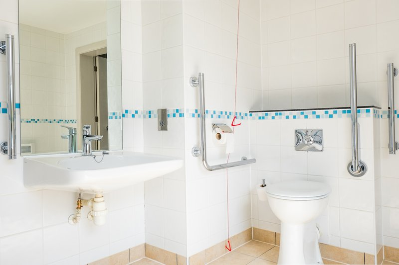 Holiday Inn Farnborough-Wheelchair accessible bathroom for guests<br/>Image from Leonardo