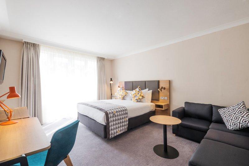 Holiday Inn Farnborough-Executive hotel room with a sofa<br/>Image from Leonardo