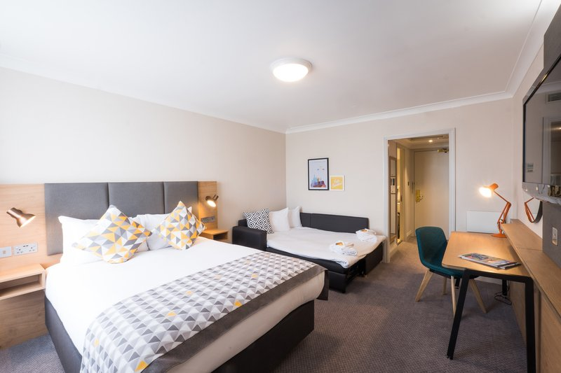 Holiday Inn Farnborough-Bedroom with a sofa bed for guests<br/>Image from Leonardo