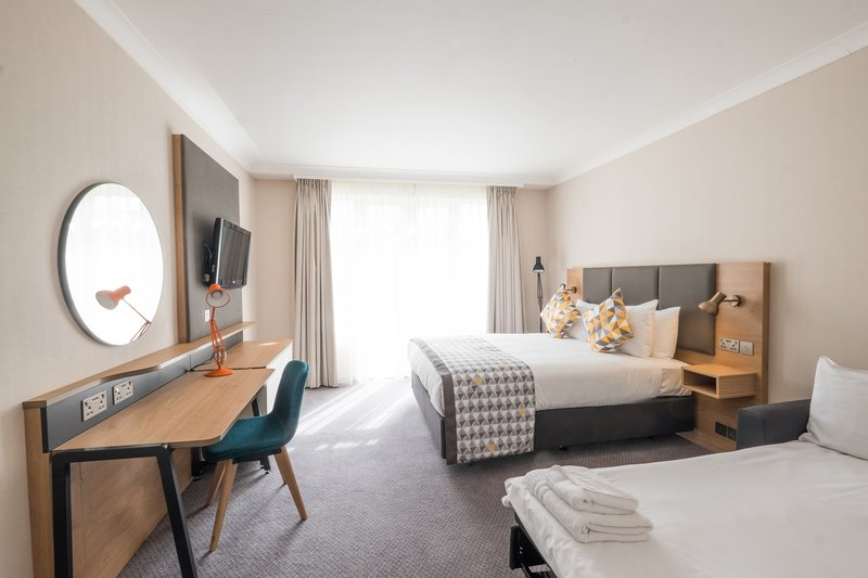 Holiday Inn Farnborough-Hotel room with a double bed and sofa bed<br/>Image from Leonardo