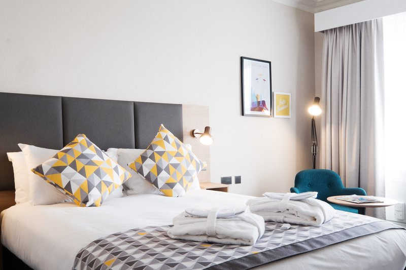 Holiday Inn Farnborough-Hotel room with a double bed and bathrobes for guests<br/>Image from Leonardo