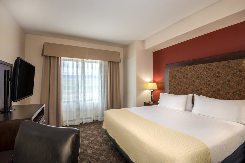 Holiday Inn Casper East - McMurry Park-Our king suites offer a separate sleeping area.<br/>Image from Leonardo