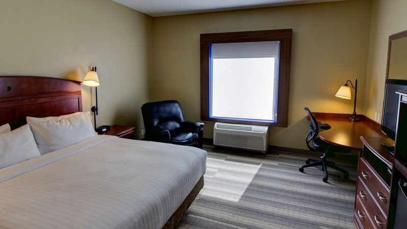 Holiday Inn Express & Suites Sioux City - Southern Hills-King Guestroom with fridge and microwave<br/>Image from Leonardo