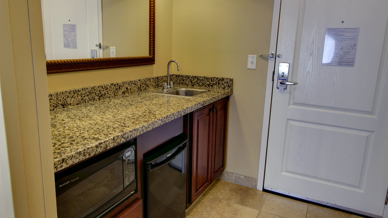 Holiday Inn Express & Suites Sioux City - Southern Hills-Kitchenette area in Two Queen Suites and King Executive Suite<br/>Image from Leonardo