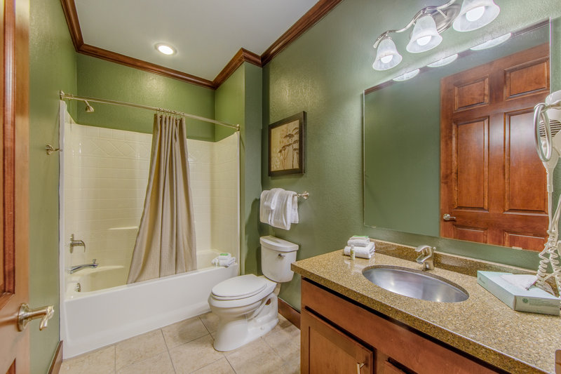 Holiday Inn Club Vacations Galveston Beach Resort-Private bathroom with shower tub combo<br/>Image from Leonardo