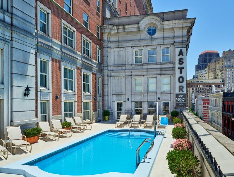 Astor Crowne Plaza French Quarter - Hotel outdoor pool overlooking Bourbon Street. <br/>Image from Leonardo
