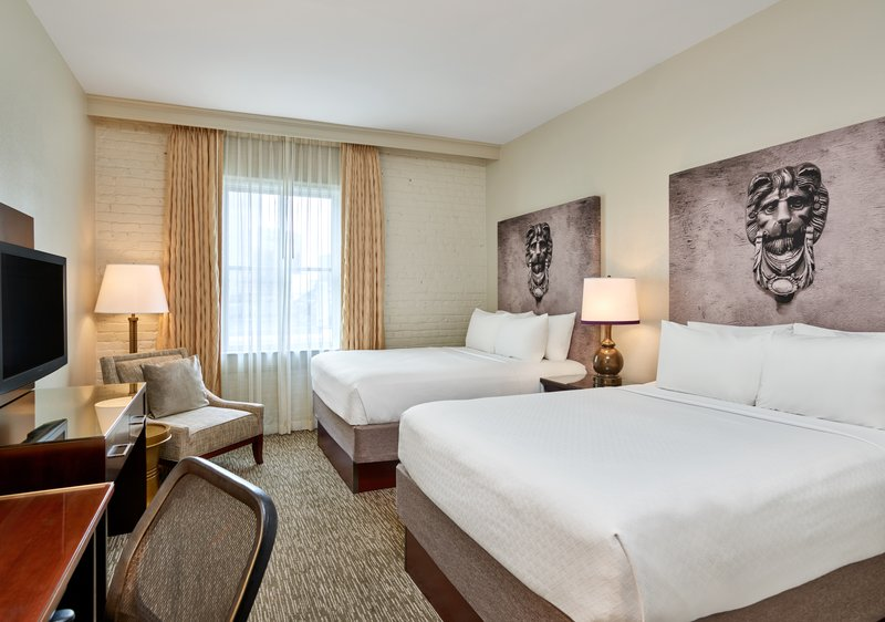 Astor Crowne Plaza French Quarter - Hotel guestroom featuring 2 queen beds. <br/>Image from Leonardo