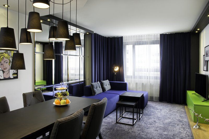 Holiday Inn Stuttgart-A roomy apartment with separate living area and a dining table.<br/>Image from Leonardo