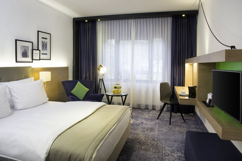 Holiday Inn Stuttgart-Standard rooms come with a queen bed and a flat-screen TV.<br/>Image from Leonardo