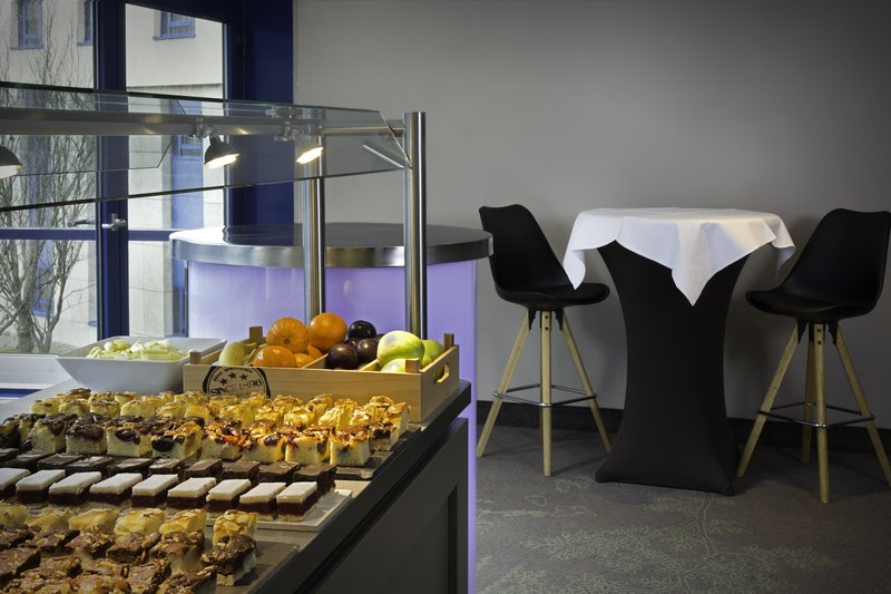 Holiday Inn Stuttgart-Fruit and desserts at a buffet in a meeting room break-out space.<br/>Image from Leonardo