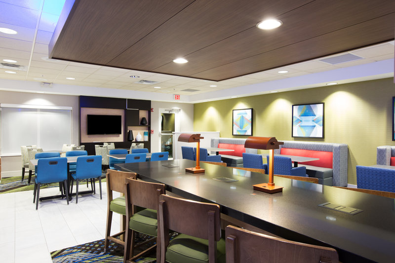 Holiday Inn Express Hastings-Try our new community table with built in wireless charging <br/>Image from Leonardo