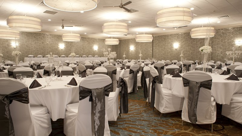 Holiday Inn Rock Island - Quad Cities-Head table and guest tables for a wedding reception in Ballroom 2<br/>Image from Leonardo
