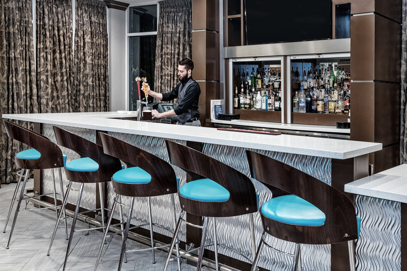 Holiday Inn Hotel & Suites College Station - Aggieland-Unwind at the bar and enjoy a beer or glass of wine.<br/>Image from Leonardo