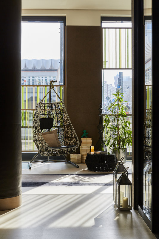 Hotel Indigo Berlin Centre Alexanderplatz-Designer seating in the hotel lobby overlooking vibrant Berlin.<br/>Image from Leonardo
